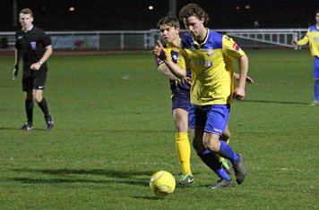 Enfield's Harry Ottaway (yellow) and Bognor's Craig Robson