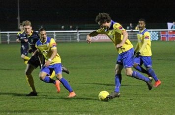Enfield's Harry Ottaway runs at the defence supported by bobby Devyne (R) and Corey Whitely