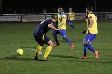 Enfield's Corey Whitely (R) sets up Bobby Devyne for a shot