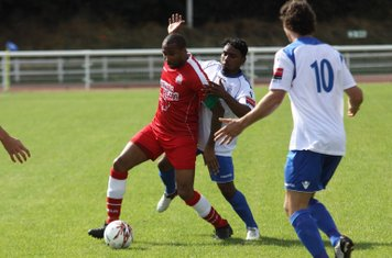 Harrow captain MArc Charles- Smith (red) holds off Nikki Ahamed