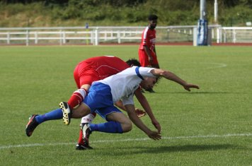 Enfield's Harry Ottaway and Harrow's Tom Willment tangle on the edge of the box.