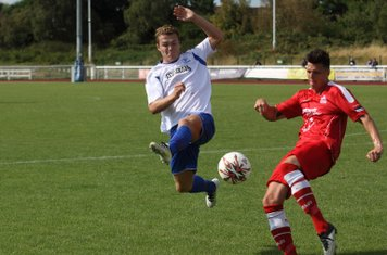 Enfield's Mickey Parcell tries to charge down a clearance from Harry Newman