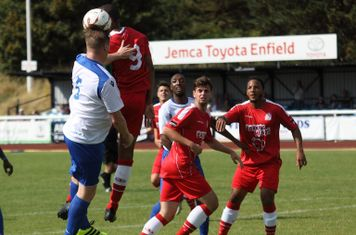 Enfield's Mark Kirby (far L) challenges Marc Charles-Smith