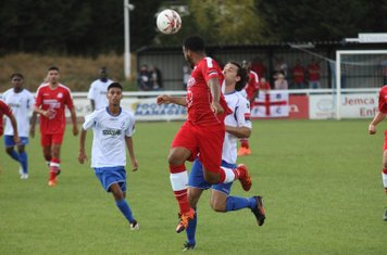 Harrow's Shaun Preddie heads clear from Harry Ottaway