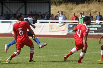 Enfield's Kelvin Bossman sees his shot deflected for a corner