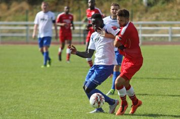 Enfield's Kelvin Bossman (L) and Harrow's Josh Webb
