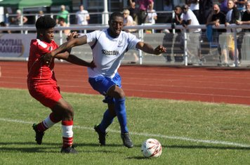 Enfield's Ricky Gabriel (R) tries to get past Max Holland