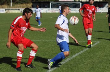 Enfield's Billy Crook controls the ball on his chest as Tom Willment waits for the right moment to challenge