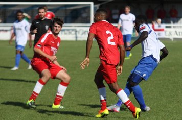 Enfield's Kelvin Bossman plays the ball between Lewis Ochoa (2) and David Taylor