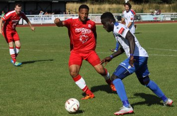Enfield's Kelvin Bossman (R) tries to find a way past Shaun Preddie