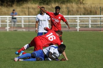 Harrow's Michael Peacock (16) and Enfield's Kelvin Bossman