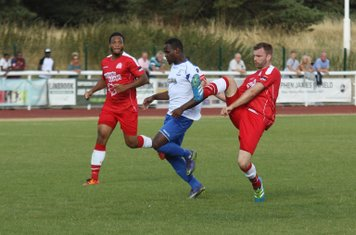 Harrow's Michael Peacock (R) challenges Nigel Neita as Shaun Preddie covers