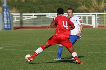 Harrow's Shaun Preddie (red)  tries to intercept a pass from Mickey Parcell