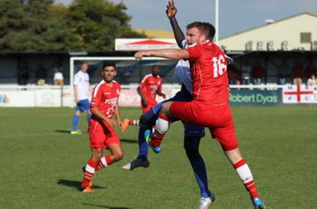 Harrow's Michael Peacock (red) challenges Kelvin Bossman
