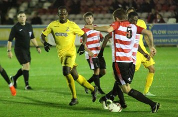 Kingstonian's Sam Page (5) and colleague Sean Bonnett-Johnson challenge each other for the ball