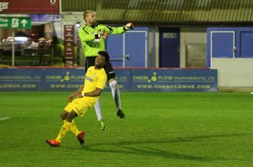 Rob Tolfrey punches clear from Enfield's Dernell Wynter
