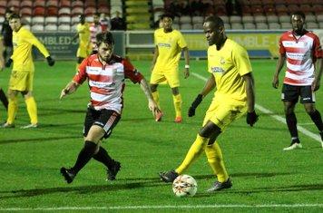 Kingstonian's Aaron Lamont (L) and Enfield's Nigel Neita