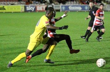 Enfield's Nigel Neita (L) challenges Youssef Bamba