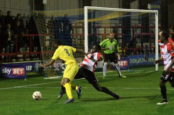 Kingstonian's Aaron Goode tackles Ricky Gabriel