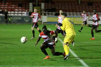 Kingstonian's Youssef Bamba (L) and Enfield's Keir Dickson
