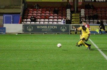 Nigel Neita (yellow) opens the scoring