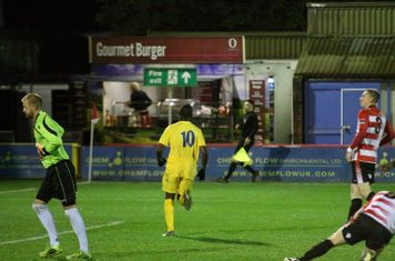 Nigel Neita (yellow) celebrates his goal