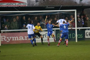 Enfield's Ricky Gabriel (3) heads the ball down but straight at keeper Danny Gay
