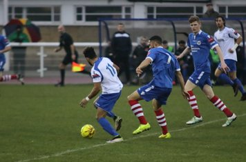 Enfield's Tyler Campbell (L) breaks clear of Luke Ingram (7) and Billy Holland