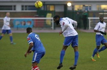Enfield's Harold Joseph heads clear from Reece Dobson