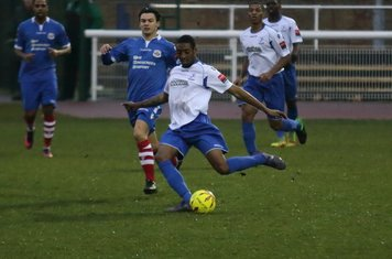 Enfield's Ricky Gabriel clears from Jack Curtis