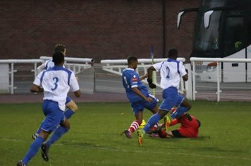 Enfield keeper Nathan McDonald brings down Reece Dobson to concede a penalty