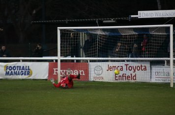 Enfield's Nathan McDonald is beaten by Callum Harrison's penalty to make the score 1-1