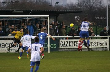 Enfield's Harry Ottaway (10) challenges at a corner