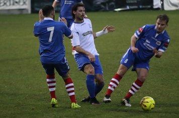 Enfield's Harry Ottaway plays the ball between Luke Ingram (L) and Callum Harrison