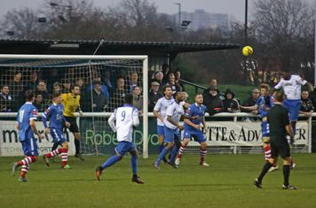 Enfield's Percy Kiangebeni (R) heads across goal