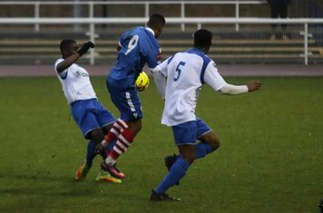 Enfield's Percy Kiangebeni (L) tackles Reece Dobson