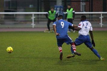 Enfield's Percy Kiangebeni (R) tackles Reece Dobson