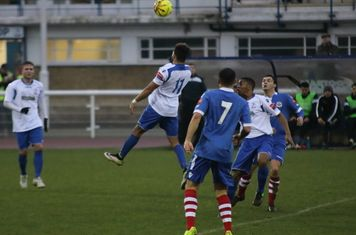 Enfield's Tyler Campbell (11) heads the ball up rather than forwards
