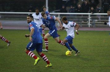 Enfield's Tyler Campbell runs at the defence. Luke Ingram checks the left wing.