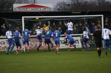 Harry Ottaway just beats Needham keeper Danny Gay to make the score 2-2