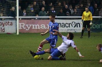 Enfield's Harry Ottaway tackles Ian Miller