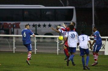 Enfield keeper Nathan MacDonald collides with teammate Jonathan Muleba