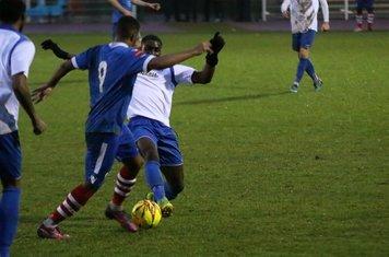 Enfield's Percy Kiangebeni tackles Reece Dobson