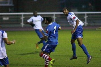 Enfield's Ricky Gabriel (R) heads clear from Reece Dobson