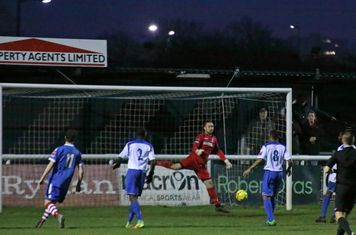 Enfield's keeper Nathan McDonald miscues a punch
