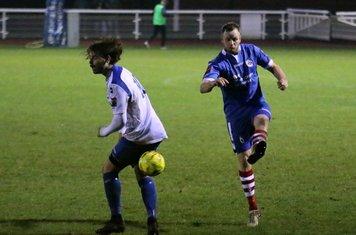 Needham's Sam Nunn clears from Harry Ottaway