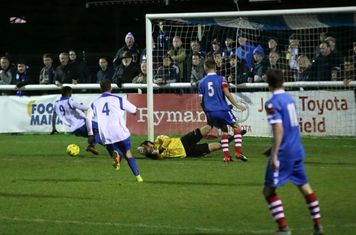 I'm not sure if Needham keeper Danny Gay got a touch to this cross but it went behind Bobby Devyne (9)