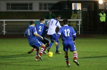 Enfield's Bobby Devyne closely marked by Callum Harrison (8), Jake Dye (2) and Kem Izzet