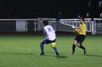 Needham keeepr Danny Gay just misses Harry Ottaway with his clearance