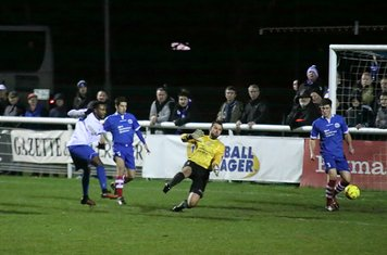 Enfield's Bobby Devyne turns and shoots but just wide